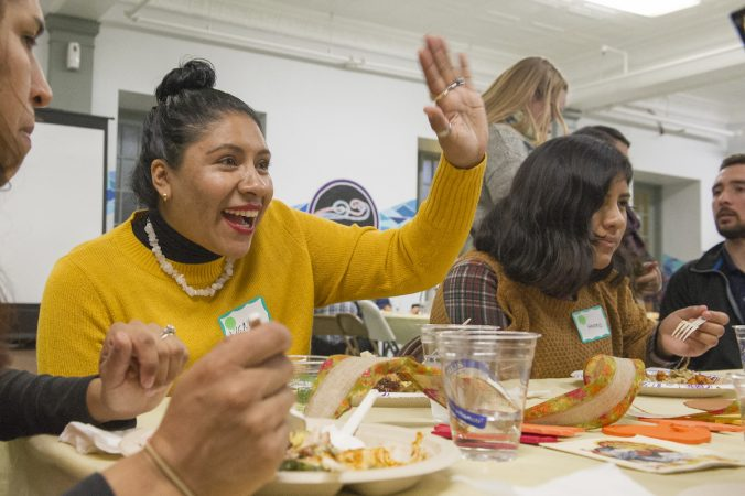 A mother and daughter, refugees from Mexico, enjoy their Thanksgiving dinner. (Jonathan Wilson for WHYY)
