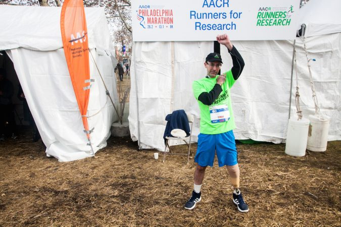 Evan Freiberg stretches before the Rothman Institute 8k Saturday. The 43-year-old is diagnosed with leiomyosarcoma, a form of cancer, and competed after losing the bottom portion of his left leg to the disease. (Brad Larrison for WHYY)