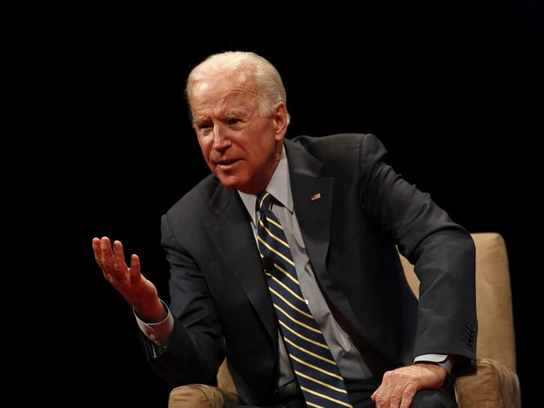 Former Vice President Joe Biden participates in a discussion on bridging political and partisan divides with Ohio Gov. John Kasich at the University of Delaware in Newark, Del., last month.
