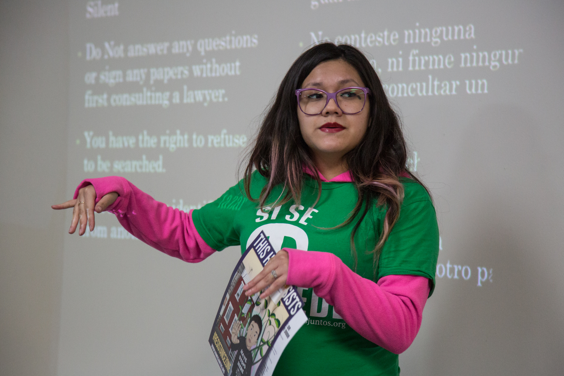 Olivia Vazquez, the community organizer for Juntos, teaches participants about their rights when ICE comes to their home.