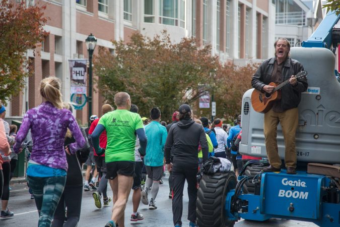 Steve Guilan, from Detroit, strums a tune to encourage his girlfriend and the other runners at the 23rd annual Philadelphia Marathon on Sunday November 19th, 2017.