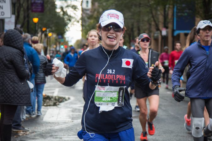 Eriko Ishibashi poses as she makes her way past mile six of the 23rd annual Philadelphia Marathon on Sunday November 19th, 2017.