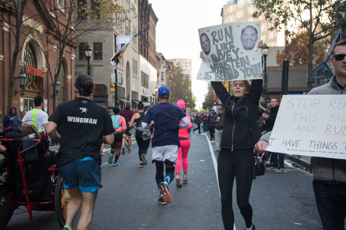 Spectators cheer on their friends and other runners as they pass by at the 23rd annual Philadelphia Marathon on Sunday, November 19th, 2017.