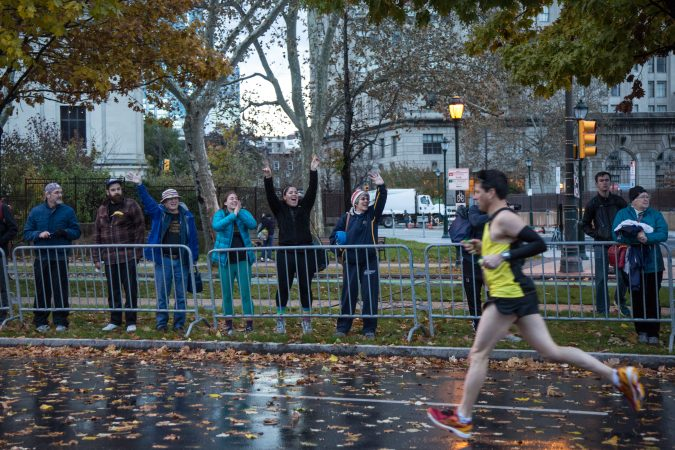 Spectators cheer on their friends and other runners as they pass by at the 23rd annual Philadelphia Marathon on Sunday November 19th, 2017. (