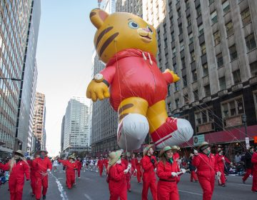 Daniel Tiger floats down Market Street during the 98th annual Philadelphia Thanksgiving Day Parade, November 23, 2017. (Emily Cohen for WHYY)