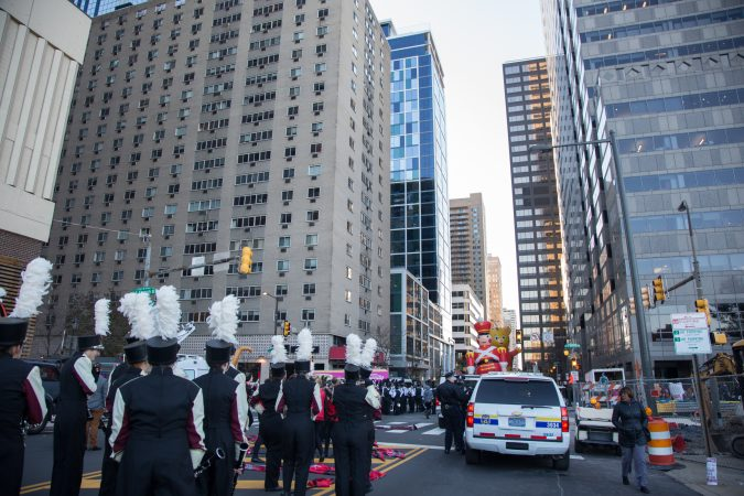 High school marching bands from all over the country line up alongside a heavy police presence at the 98th annual Philadelphia Thanksgiving Day Parade, November 23, 2017. (Emily Cohen for WHYY)