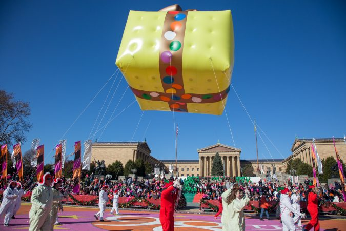 A present balloon floats over the Philadelphia Museum of Art during the 98th annual Philadelphia Thanksgiving Day Parade, November 23, 2017. (Emily Cohen for WHYY)