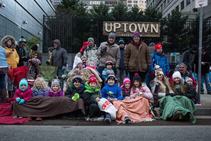 The Radetich-Coluter family has been coming to the annual Thanksgiving day Parade in Philadelphia for 35 years. (Emily Cohen for WHYY)