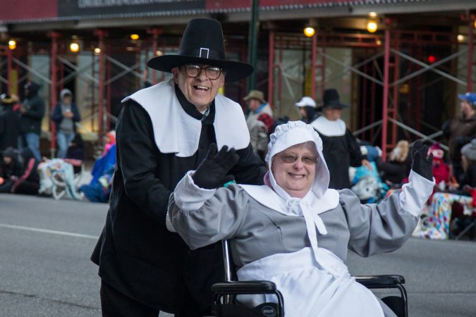 A couple dresses up as pilgrims to march in the 98th annual Philadelphia Thanksgiving Day Parade, November 23, 2017. (Emily Cohen for WHYY)