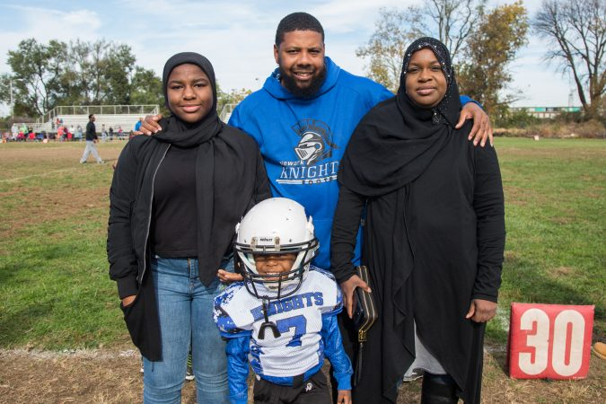 Rickey Duncan stands with his wife, Zahira, and his children, step-daughter, Rabi'ah, 15, and son, Zaid, 4.