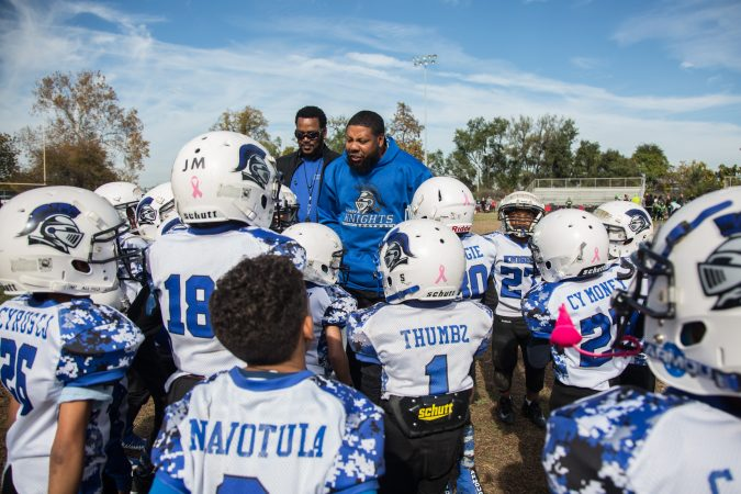 Rickey Duncan, center, helps pump up his 6U team before their game.