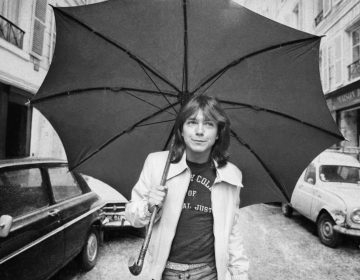 David Cassidy walks down a street in London in April 1974.