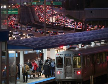 Hopefully these Chicago travelers had plenty to keep them entertained Tuesday evening. That looks like it might have taken a while. (Scott Olson/Getty Images)