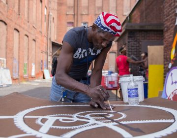 William Clack, who lives near the abandoned warehouse in Kensington, contributed many panels to the installation.  (Lindsay Lazarski/WHYY)