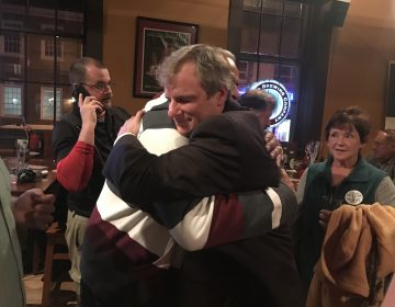 York City Council President Michael Helfrich, a Republican, embraces a supporter after winning the mayor's race. (Emily Previti/WITF)