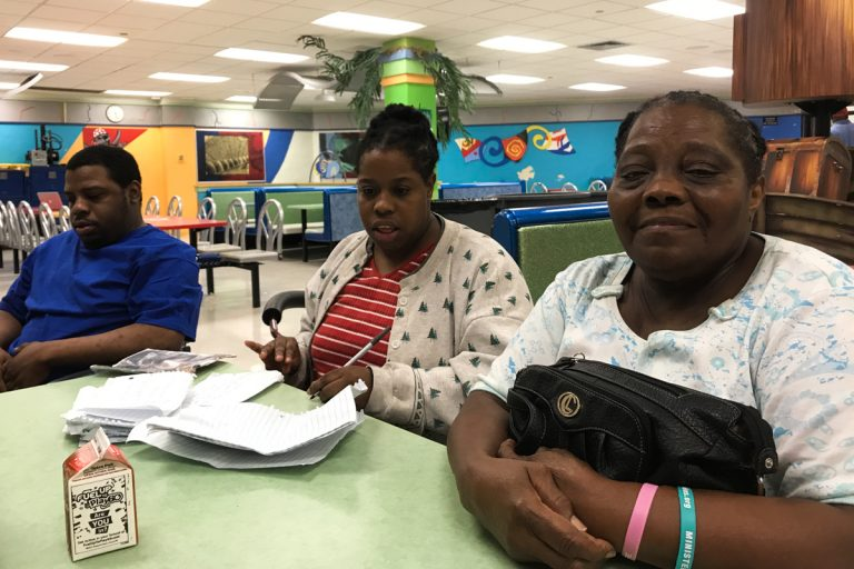 José, Nelly and Gloria Guity in the cafeteria of Miami Edison Senior High School the day before Irma hit Miami. (Kate Stein/WHYY)