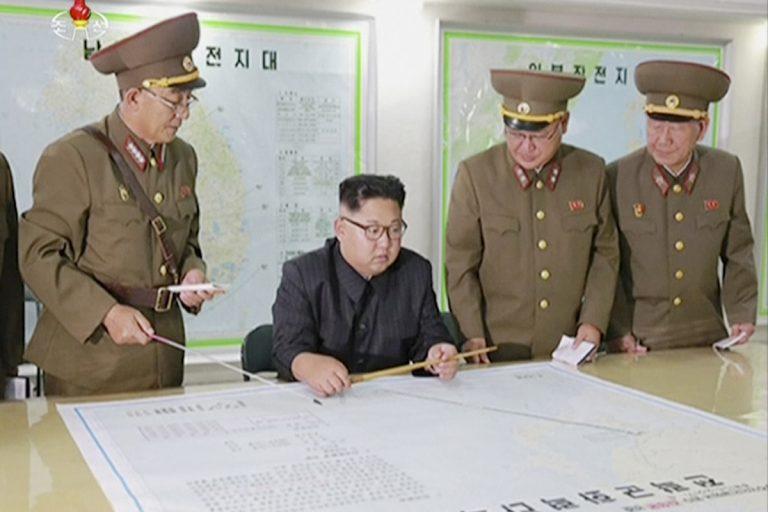 North Korean leader Kim Jong Un receives a military briefing