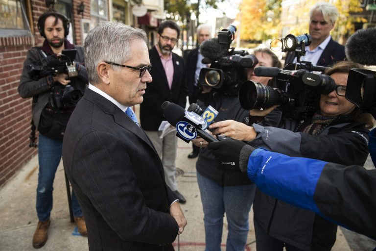 Larry Krasner speaks with members of the media outside of his polling place