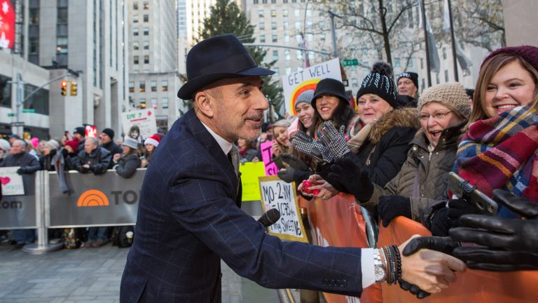 Matt Lauer greets people in a crowd outside of NBC studios in New York City.