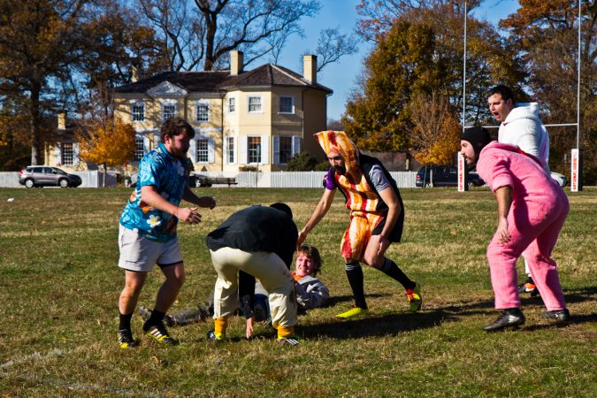 The Handsome Gents battle the Northeast Irish at the Apple Pie 7s Rugby Tournament in Fairmount Park. (Kimberly Paynter/WHYY)