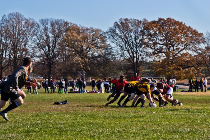 The Rogue Samurai Men battle the Hazbro Blazers at the Apple Pie 7s Rugby Tournament in Fairmount Park. (Kimberly Paynter/WHYY)