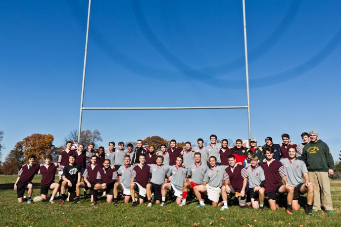 St. Joe's Prep alum rugby players pose for a team pic at the 9th annual Apple Pie 7s Rugby Tournament in Fairmount Park. (Kimberly Paynter/WHYY)