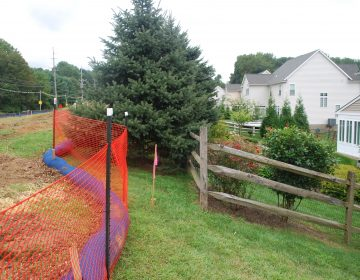 An orange fence separates a Delaware County development from a right-of-way for the Mariner East 2 pipeline.