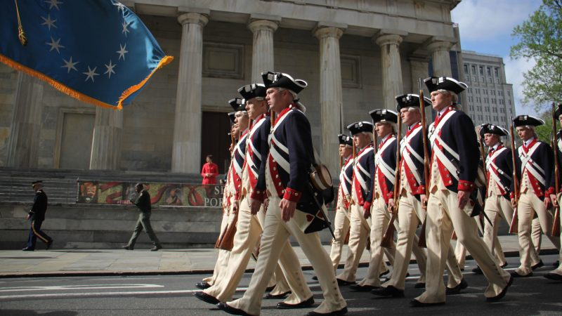 Members of The Old Guard, 3rd U.S. Infantry Regiment, march down Chestnut Avenue to the Museum of the American Revolution for the grand opening of the museum on April 19, 2017. (Emma Lee/WHYY)