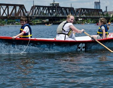 Children row in a Philadelphia Waterborne boat on the Schuylkill River
