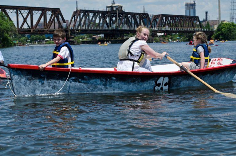 Children row in a Philadelphia Waterborne boat on the Schuylkill River