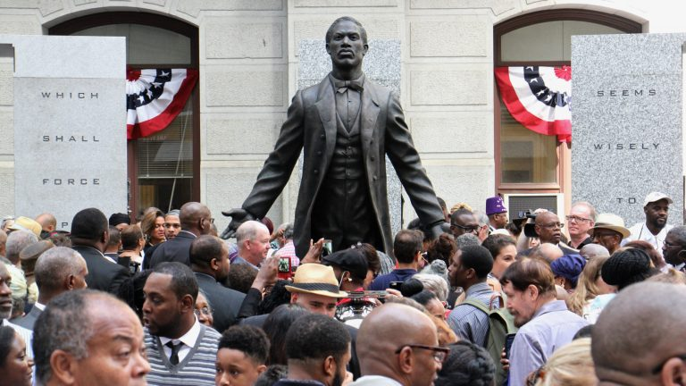An eager crowd surrounds the statue of Octavius Catto after its unveilling on the Southwest apron of City Hall. (Emma Lee/WHYY)