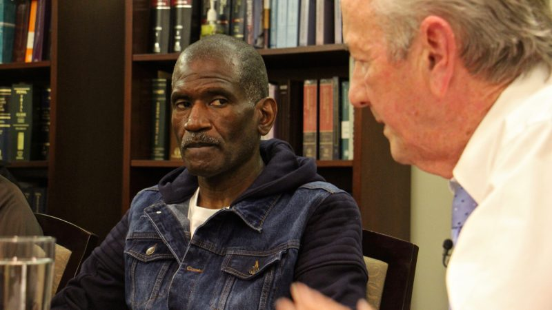 Kevin Brinkley (left) listens to an apology from attorney Gerald Dugan, who 40 years ago prosecuted the murder case that got Brinkley a life sentence. Dugan has since changed his mind about Brinkley's role in the murder of Charles Haag. (Emma Lee/WHYY)