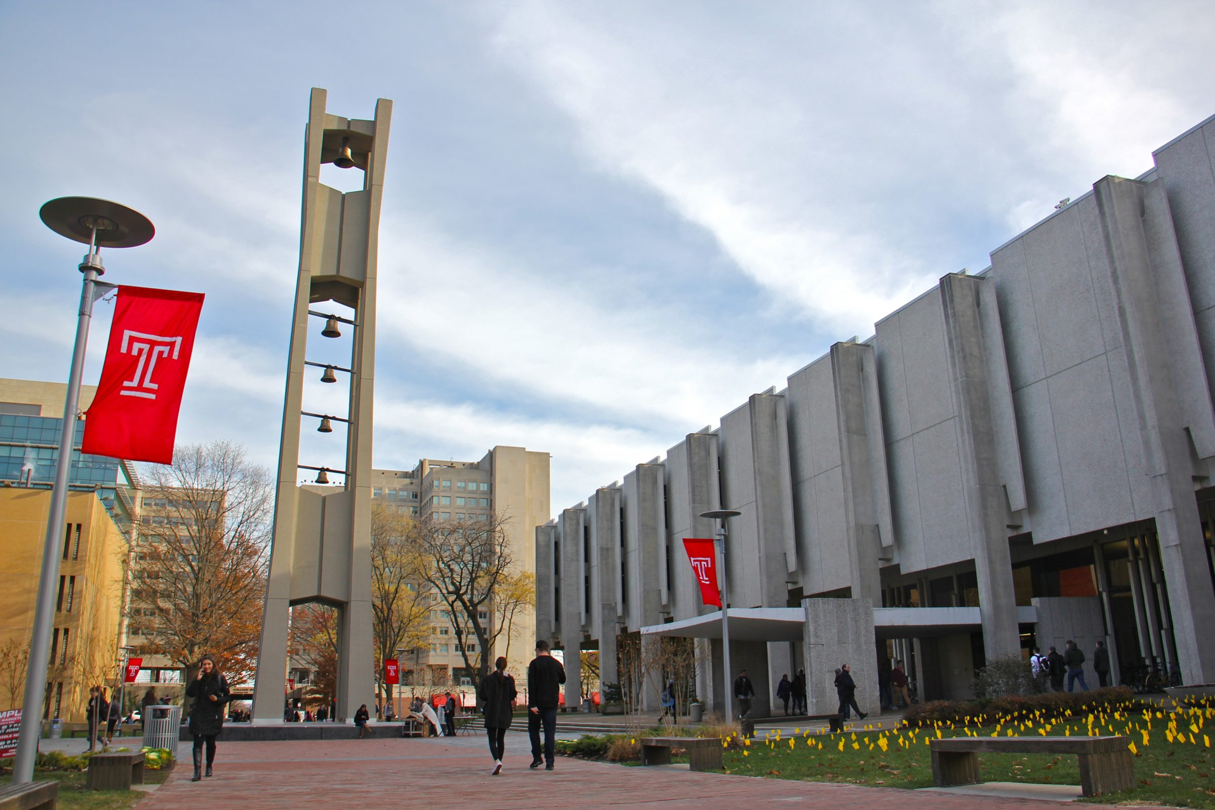 The Temple university quad which features a tall bell tower in the center and several buildings around the perimeter. Photo used courtesy of Temple University.
