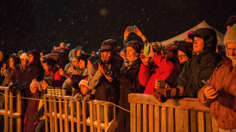 The crowds watch in awe as they watch the phoenix catch fire at the 14th Annual Firebird Festival in Phoenixville, PA December 9th 2017. (Emily Cohen for WHYY)