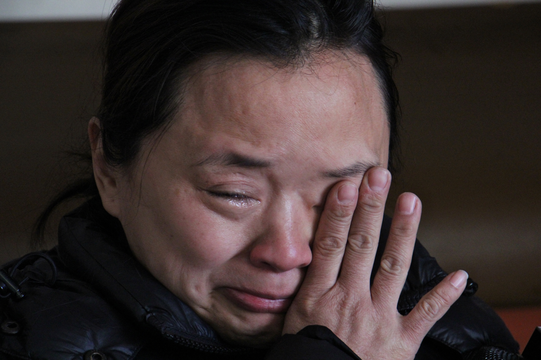 Stop-and-go owner Michelle Tran fights back tears at the thought of losing her plexiglass protection.