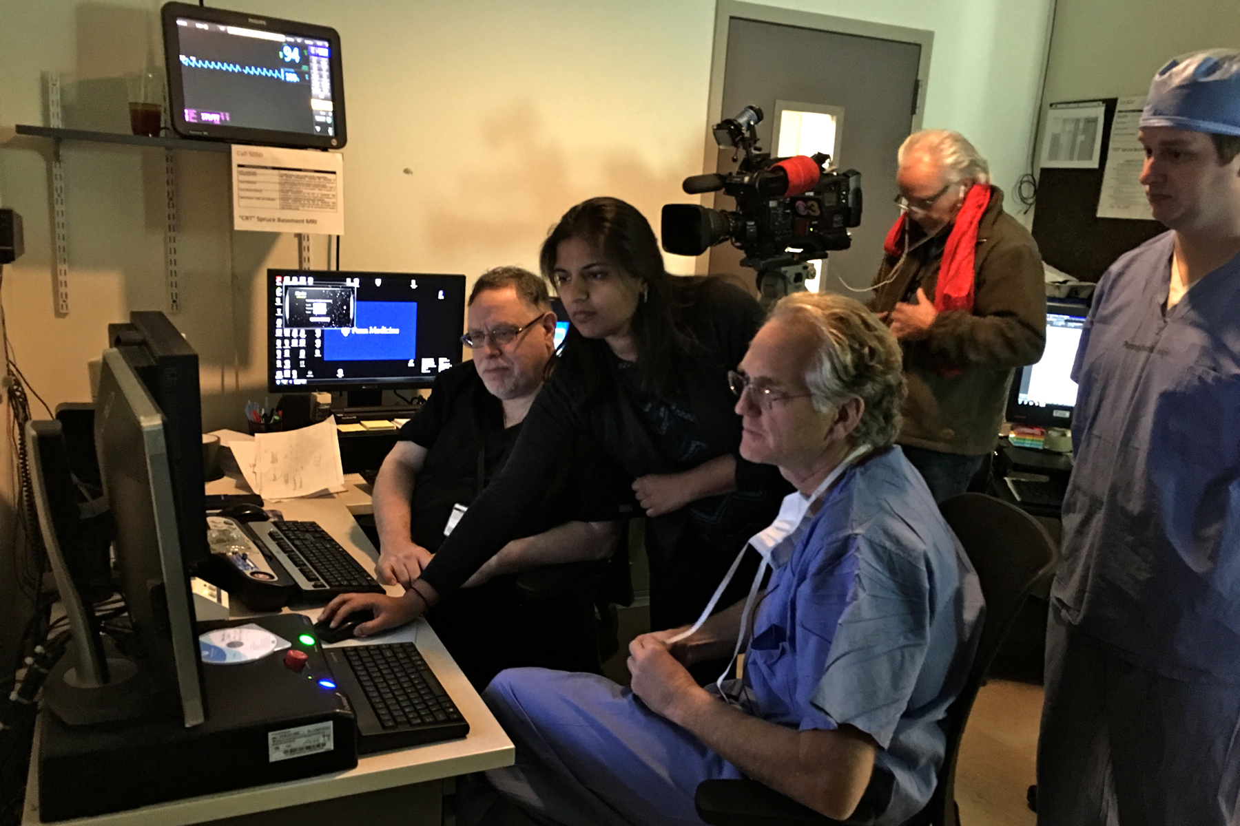 Dr. Gordon Baltuch oversees MRI and CT scans as he preps for an MRI-guided targeted ultrasound procedure.