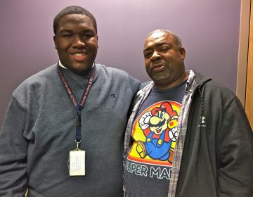 Ahmad Harrington (left) stands beside his father, James.