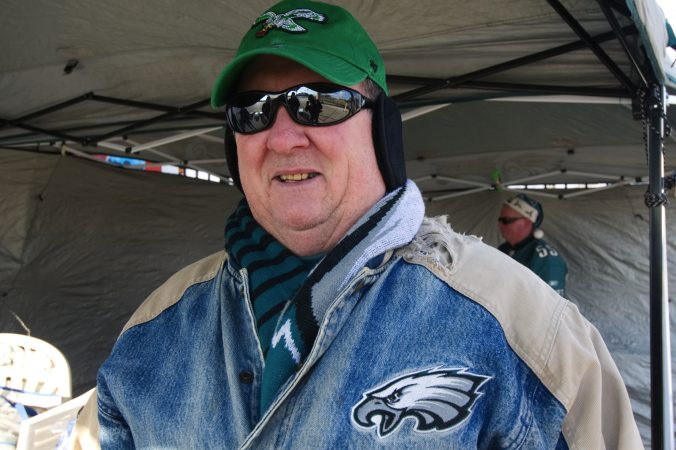 The twenty-five year old jacket worn by Greg Buchanan serves as his lucky charm as he sets up to tailgate with friends and family ahead of the Raiders vs. Eagles Christmas Day game, at the Lincoln Financial Field.