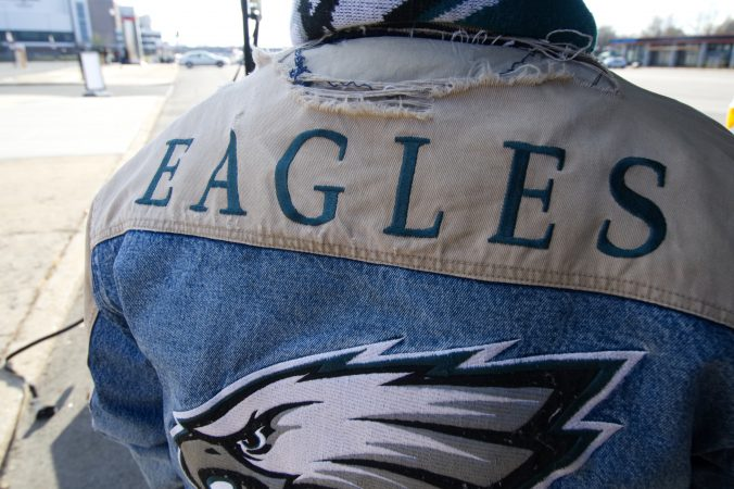 The twenty-five year old jacket worn by Greg Buchanan serves as his lucky charm as he sets up to tailgate with friends and family ahead of the Raiders vs. Eagles Christmas Day game, at the Lincoln Financial Field, on Monday.