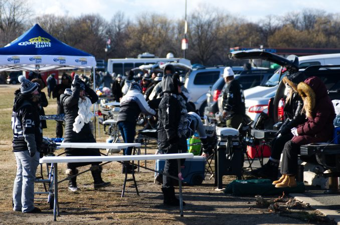 Raiders fans set up to tailgate ahead of the Raiders vs. Eagles Christmas Day game, at the Lincoln Financial Field, on Monday.