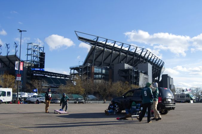 Fans set up to tailgate ahead of the Raiders vs. Eagles Christmas Day game, at the Lincoln Financial Field, on Monday.