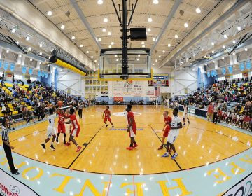 Basketball teams from California to Florida, Maryland, New Jersey, Pennsylvania, Washington, D.C. and New York along with Delaware players came together for the Annual Slam Dunk To The Beach held at Cape Henlopen High School in Lewes on December 27-29.  (Chuck Snyder/for WHYY)