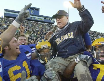 Delaware coach Tubby Raymond is hoisted onto the shoulders of his players after becoming the ninth college football coach to reach 300 wins, after Delaware beat Richmond 10-6 in Newark, Del., Saturday, Nov. 10, 2001. Raymond died this week at the age of 92. (William Bretzger/AP Photo)