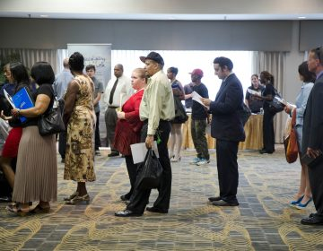 People wait in line to meet with recruiters during a job fair in Philadelphia