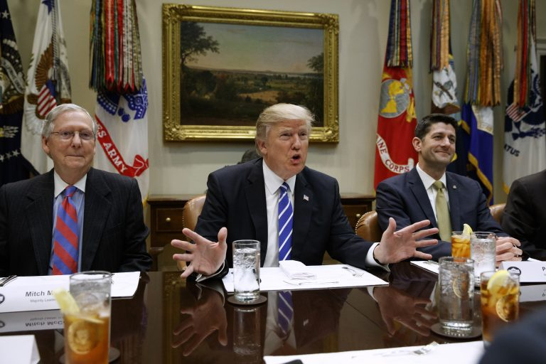 FILE - In this March 1, 2017, file photo President Donald Trump, flanked by Senate Majority Leader Mitch McConnell of Ky., left, and House Speaker Paul Ryan of Wis., speaks in the Roosevelt Room of the White House in Washington.