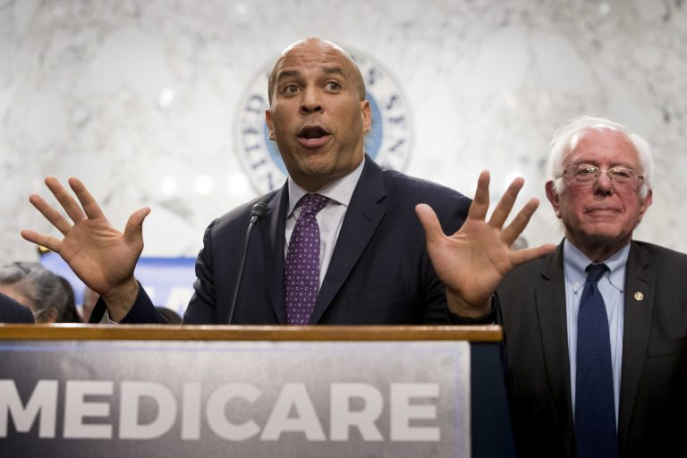 Sen. Cory Booker and Sen. Bernie Sanders speak during a news conference on Capitol Hill in Washington to unveil their Medicare for All legislation to reform health care.