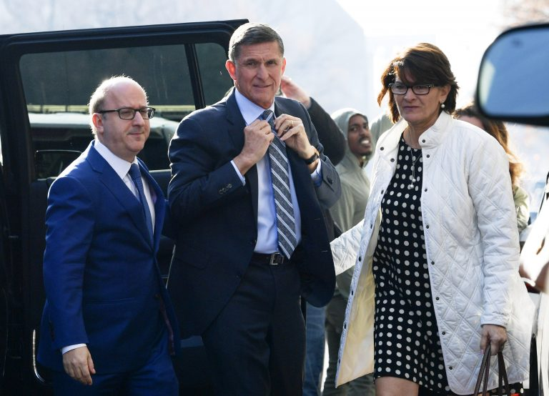 Former Trump national security adviser Michael Flynn, center, arrives at federal court in Washington, Friday, Dec. 1, 2017. Court documents show Flynn, an early and vocal supporter on the campaign trail of President Donald Trump whose business dealings and foreign interactions made him a central focus of Mueller's investigation, will admit to lying about his conversations with Russia's ambassador to the United States during the transition period before Trump's inauguration.