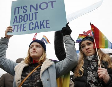 Lydia Macy, 17, left, and Mira Gottlieb, 16, both of Berkeley, Calif., rally outside of the Supreme Court which is hearing the 'Masterpiece Cakeshop v. Colorado Civil Rights Commission' today, Tuesday, Dec. 5, 2017, in Washington.