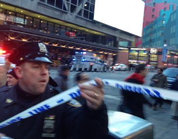 Police respond to a report of an explosion near Times Square on Monday, Dec. 11, 2017, in New York.