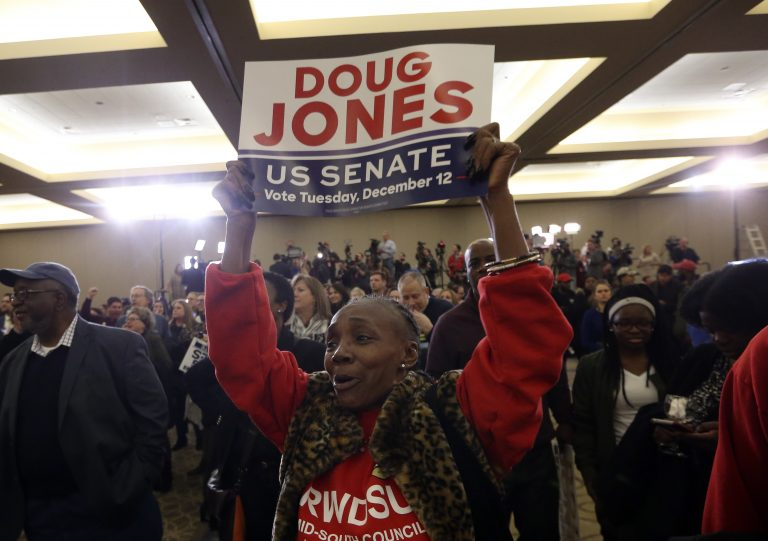 A supporter of Democratic candidate for U.S. Senate Doug Jones what for results during an election-night watch party Tuesday, Dec. 12, 2017, in Birmingham , Ala. Jones defeated Republican Roy Moore.